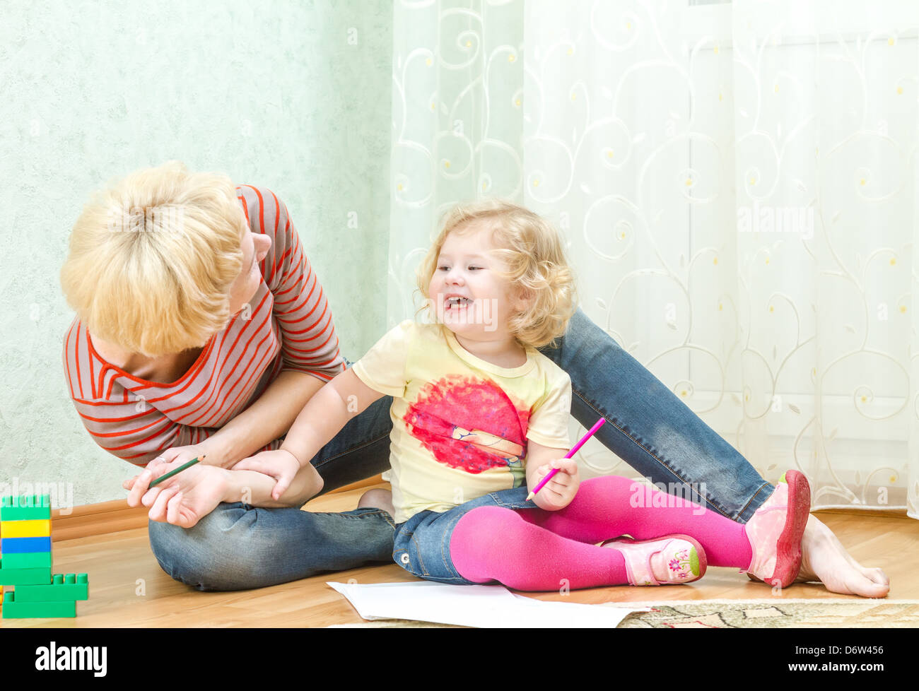 Mother with a little daughter playing - Stock Image