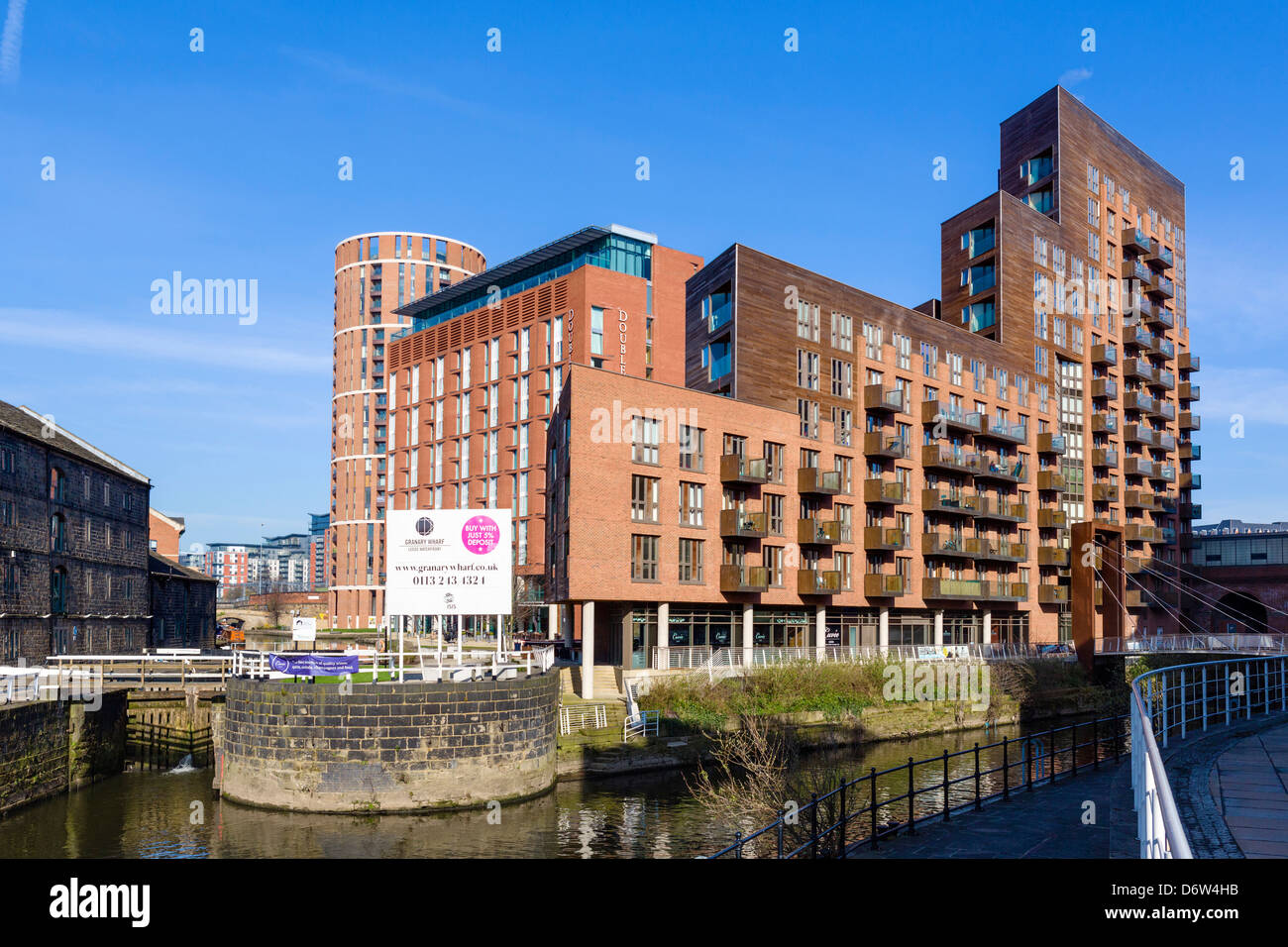 Waterfront apartments and the DoubleTree Hotel at Granary Wharf in the city centre, Leeds, West Yorkshire, UK - Stock Image