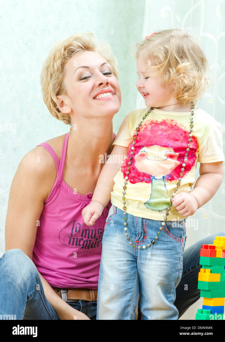 portrait of happy mother and daughter - Stock Image