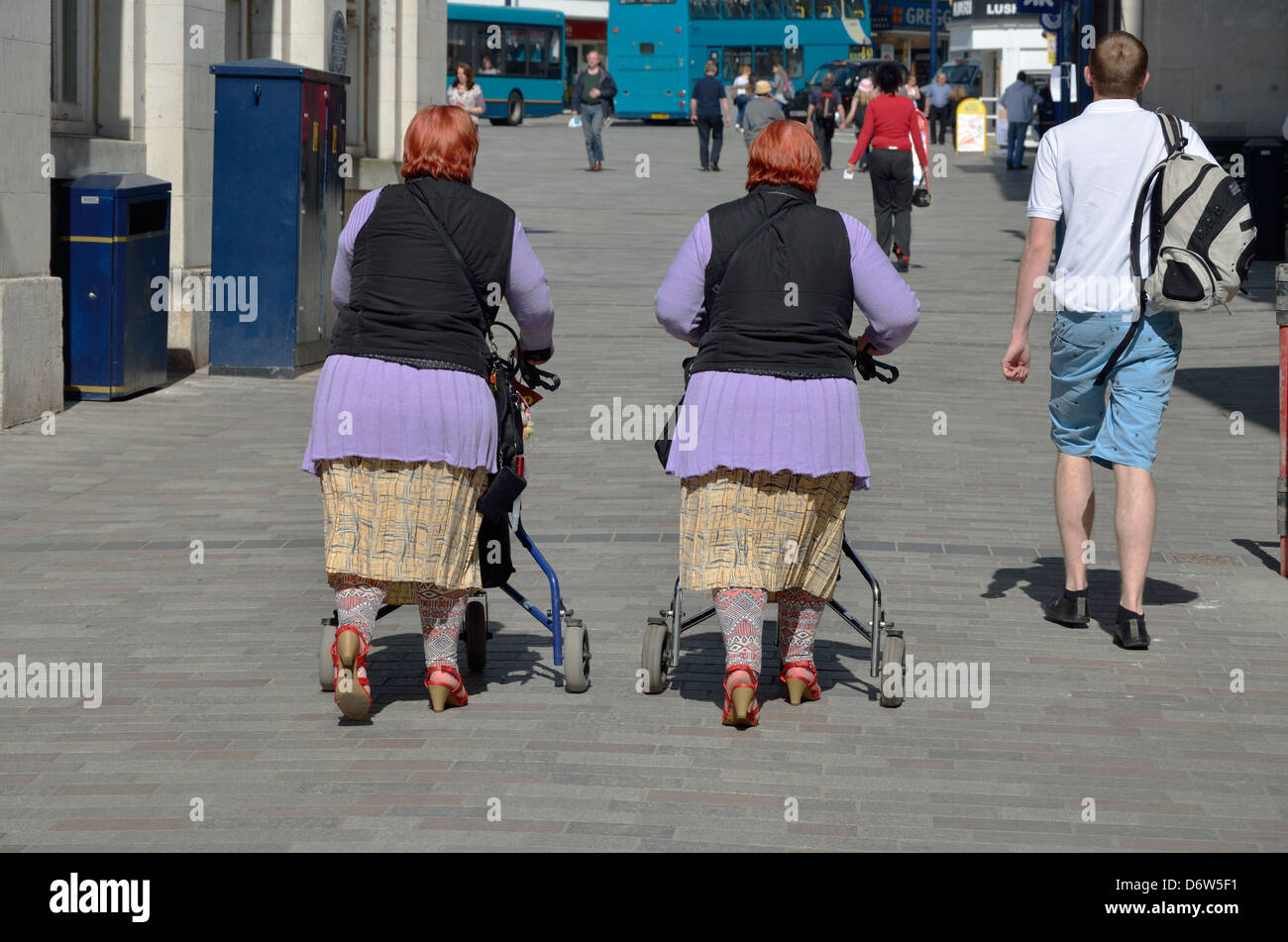 Maidstone, Kent, England, UK. Two middle-aged female identical twins (women) dressed the same - Stock Image