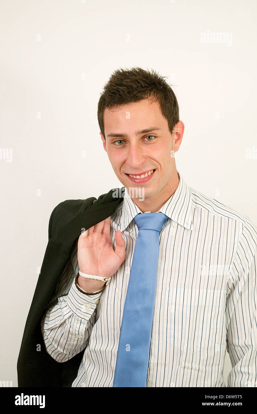 Young executive smiling and looking at the camera. - Stock Image