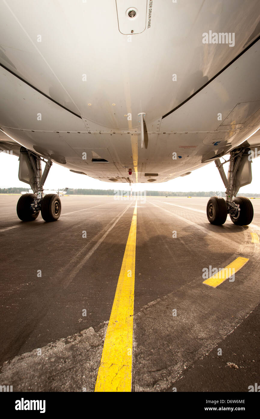 Undercarriage of jet plane - aircraft pictured from below - Stock Image