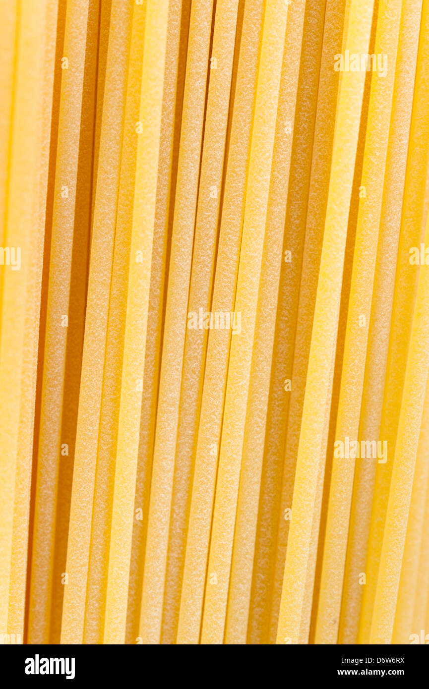 Pasta or spaghetti on a white background, close in. uncooked. - Stock Image