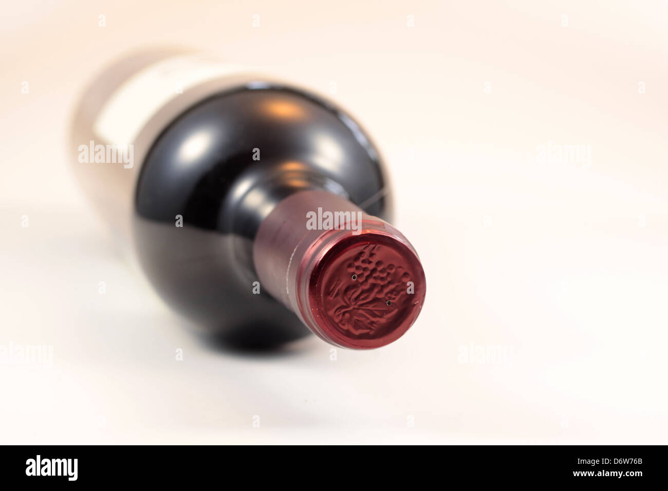 Close up view of isolated red wine bottle - Stock Image