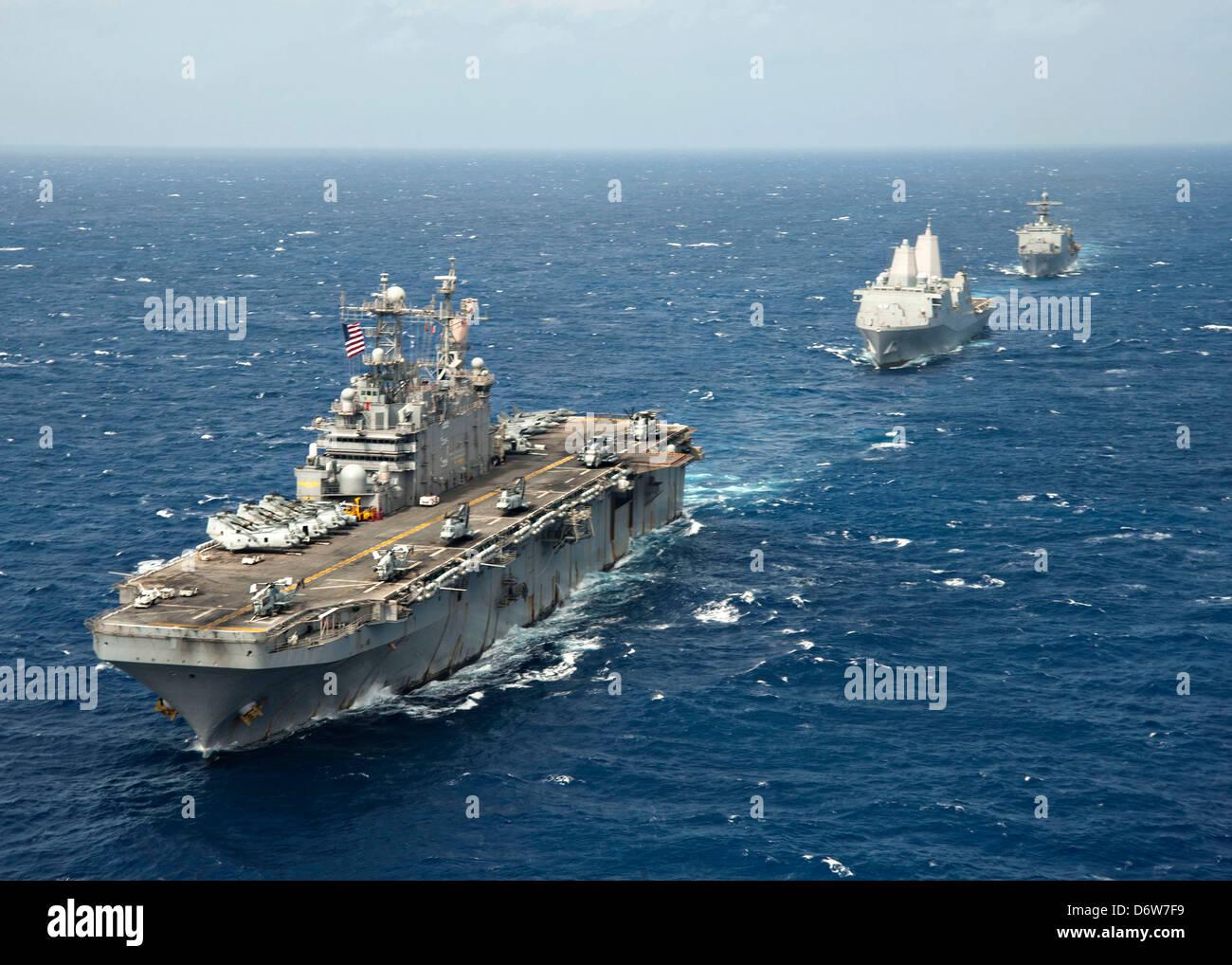 US Navy Amphibious assault ship USS Peleliu leads amphibious transport dock ship USS Green Bay and amphibious dock Stock Photo