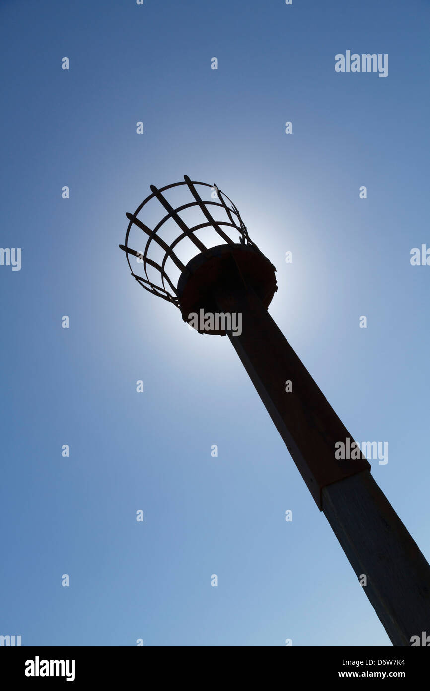 A hill-top beacon photographed against the midday sun - Stock Image