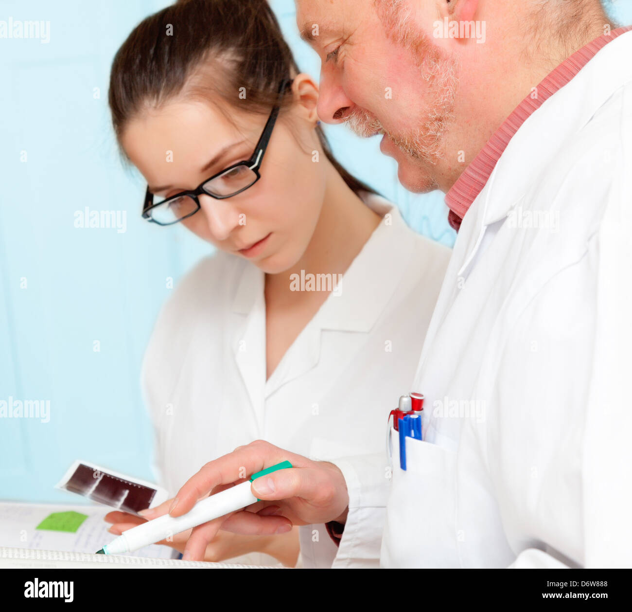 Council of physicians review the results of a genetic test - Stock Image
