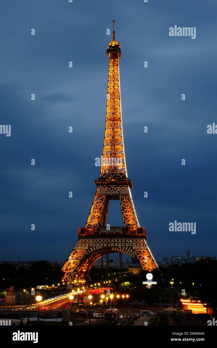 Eiffel Tower at sunset, sparkling Eiffel Tower at night, weekend in romantic Paris, icon of Paris, iconic structure - Stock Image