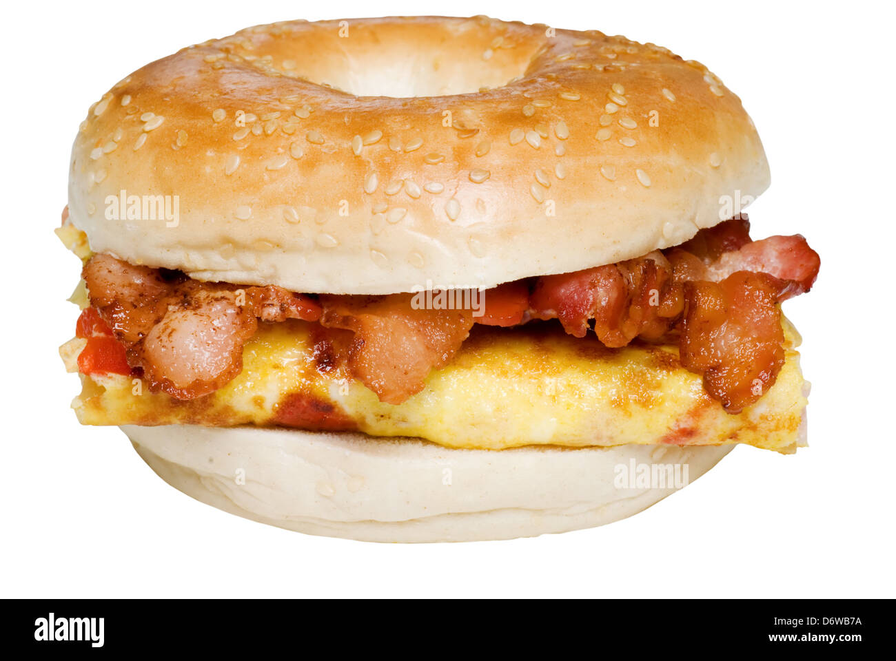Isolated Bagel Omelet and bacon sandwich close up - Stock Image