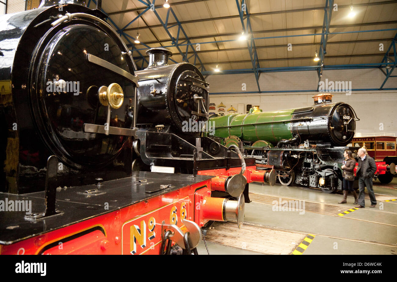 People looking at the steam engines inside the  National Railway Museum, York, Yorkshire UK - Stock Image