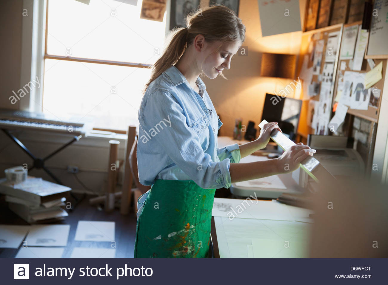 Female design professional working on silk screen - Stock Image