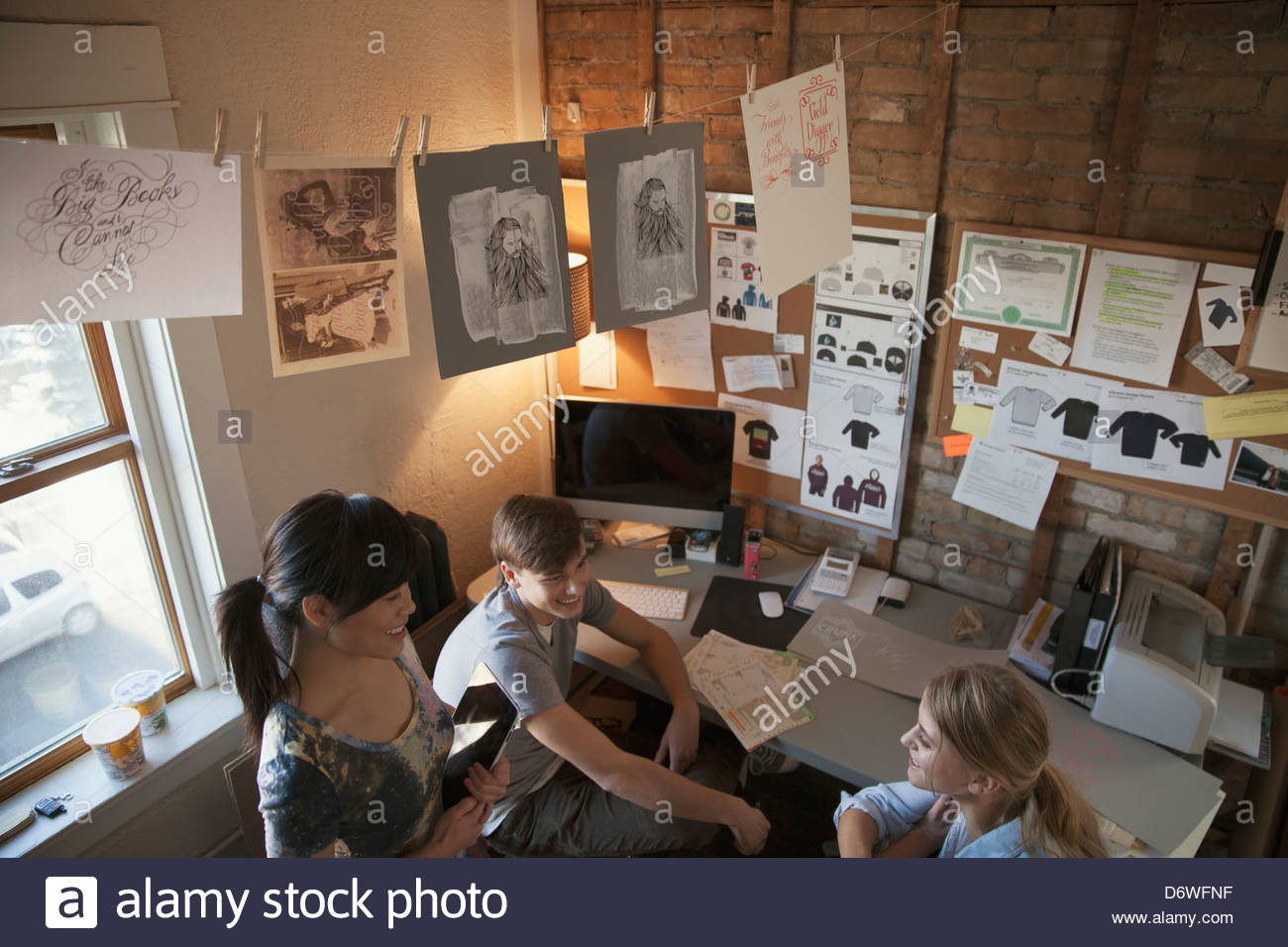 High angle view of design professionals in discussion at workshop - Stock Image