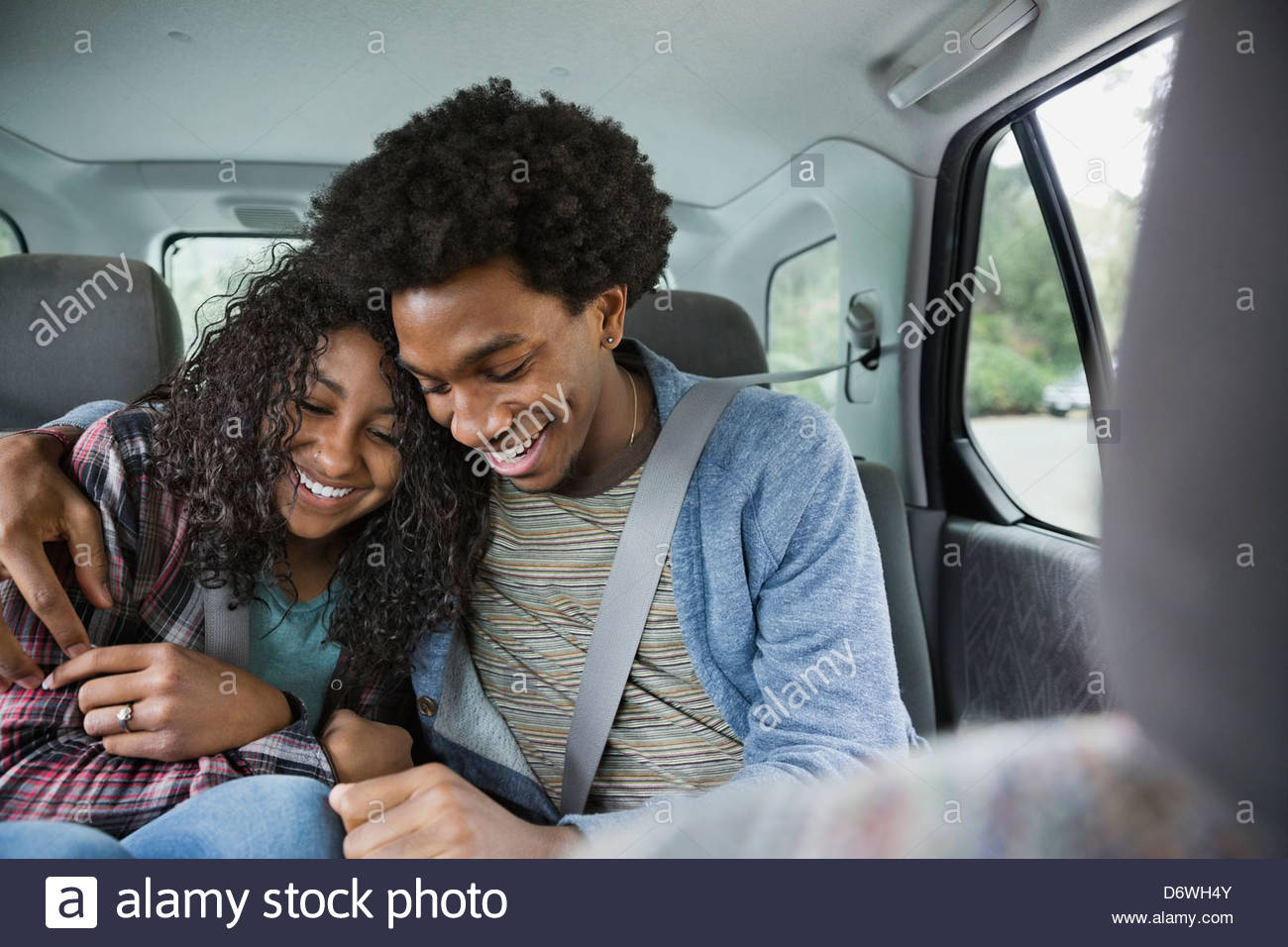 Romantic young couple sitting in truck - Stock Image