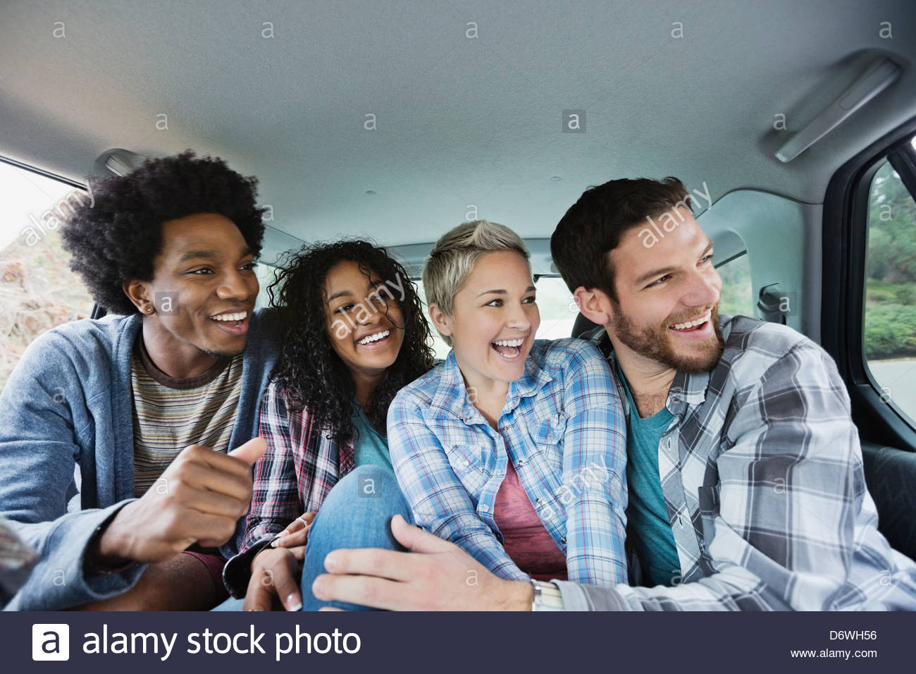 Cheerful friends enjoying road trip - Stock Image