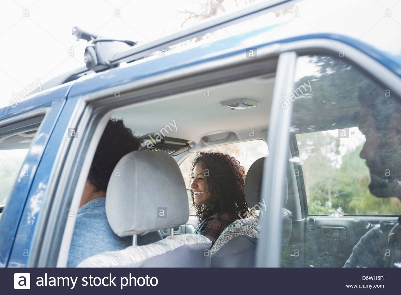 View through window of friends on road trip - Stock Image