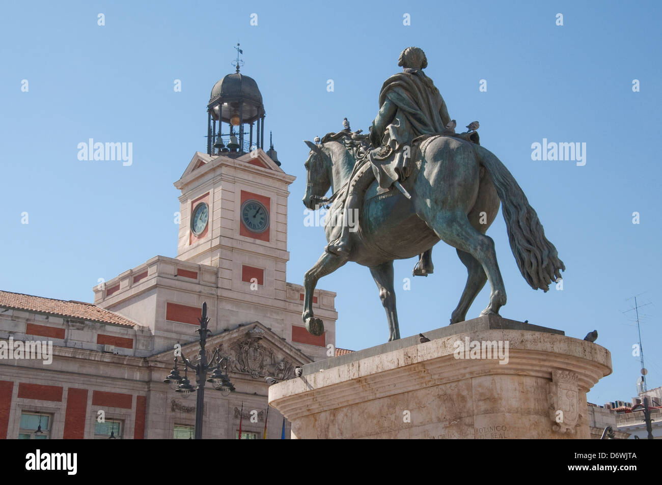 Spain, Madrid, Low angle view of statue of mounted King Charles III in Puerto del Sol plaza Stock Photo