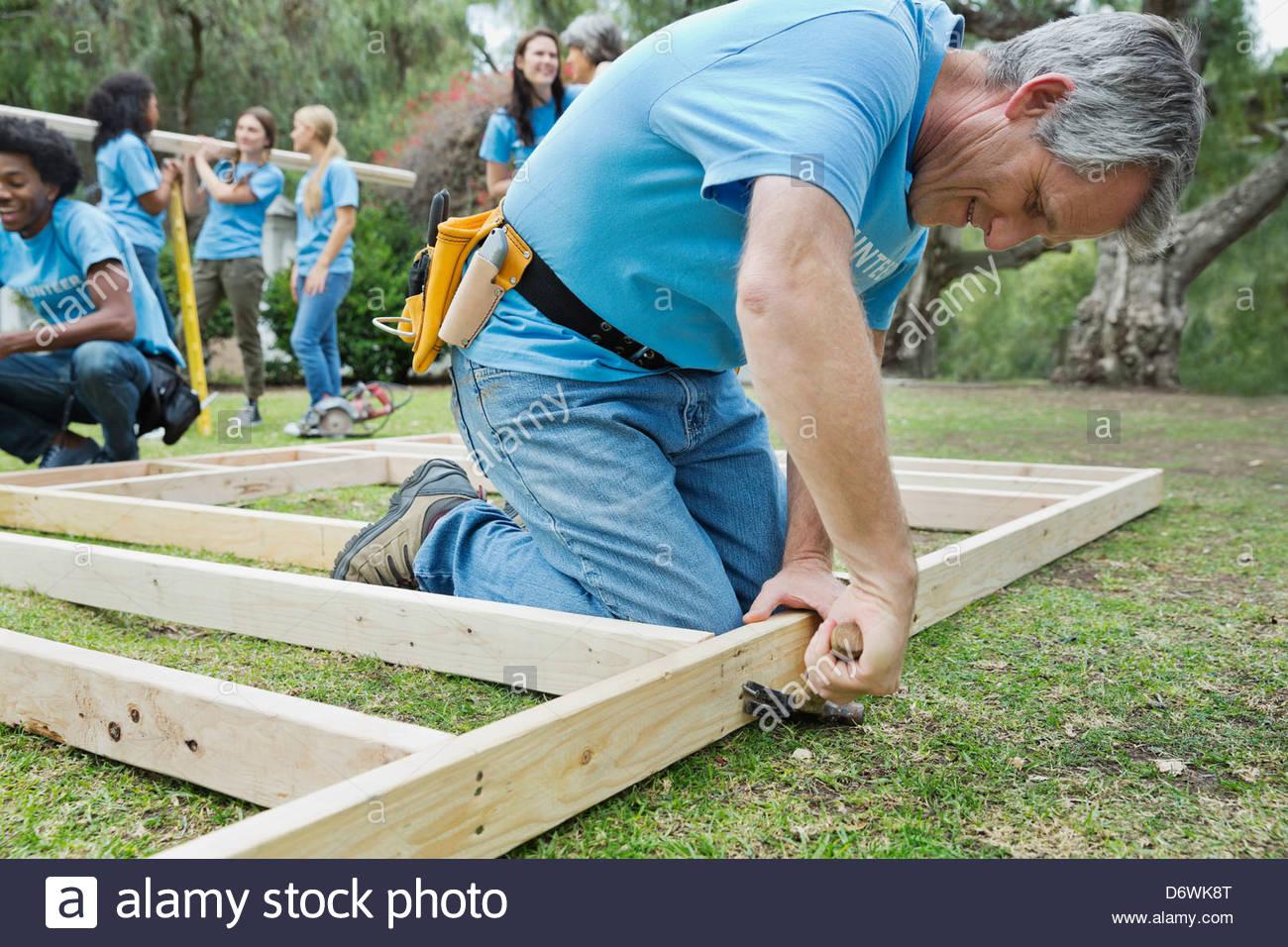 Man Hammer Wood Nail Plank Stock Photos & Man Hammer Wood Nail Plank ...