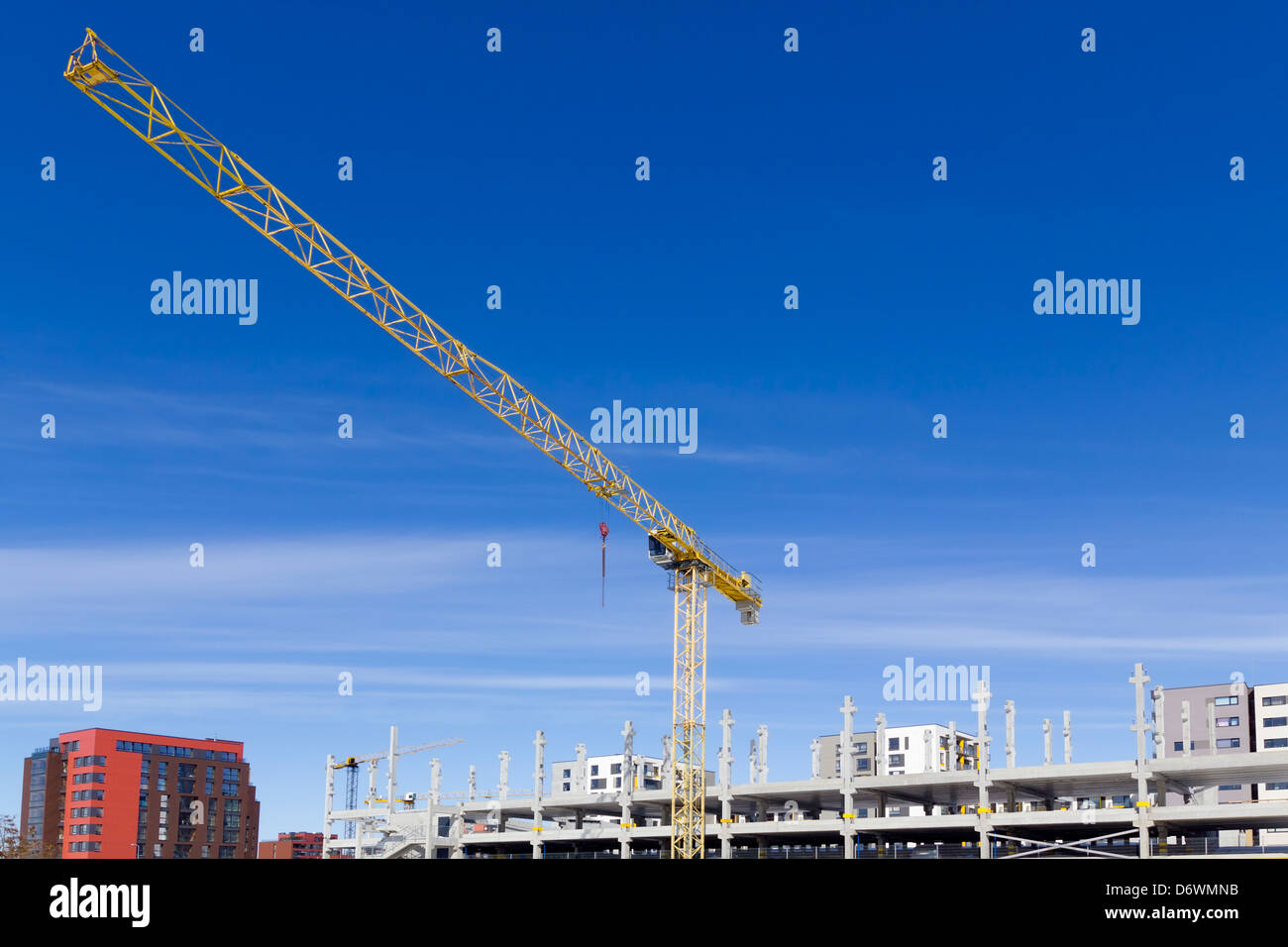 XXI century. All of us together build the new modern city concept. Bright sunny spring day. - Stock Image