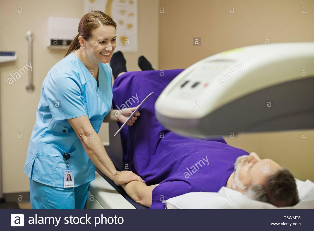 Senior man having bone denisty test - Stock Image