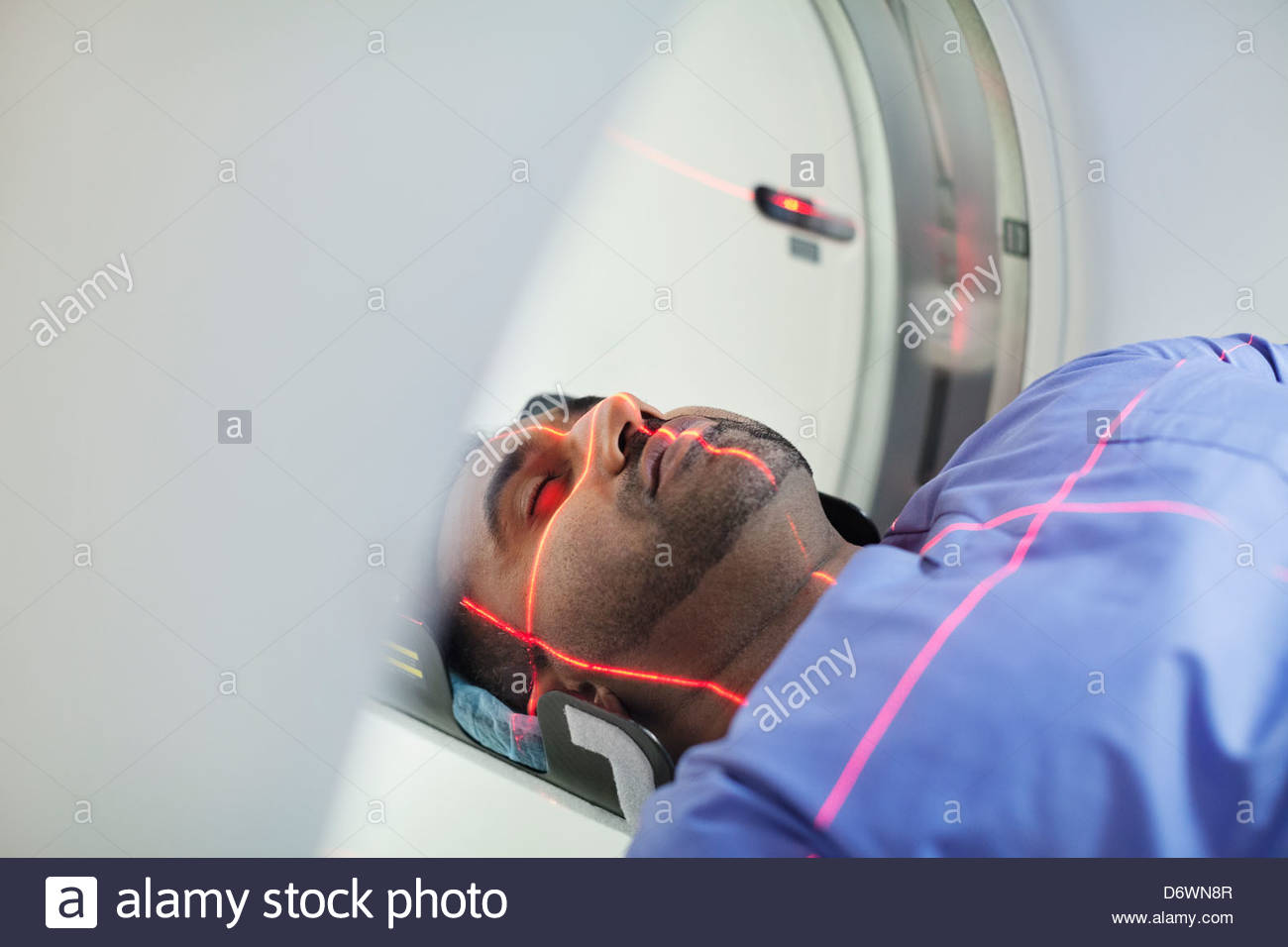 Mid adult male patient undergoing CAT scan - Stock Image