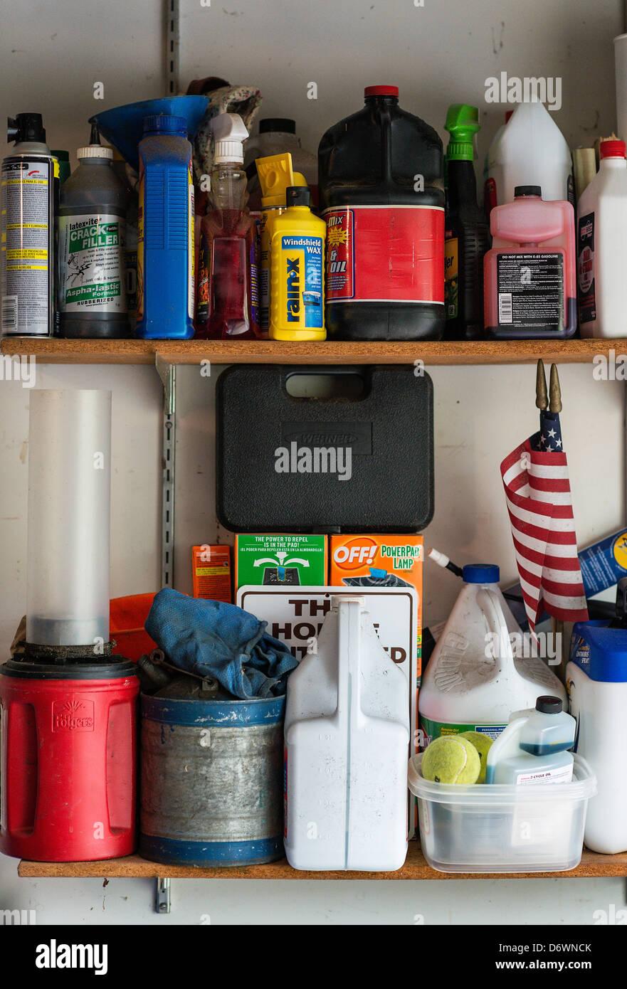 Product storage on a garage shelf. - Stock Image