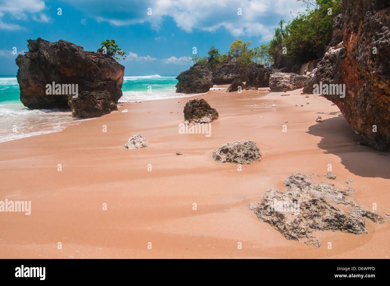 Tropical beach with volcanic rocks, Bali, Indonesia - Stock Image