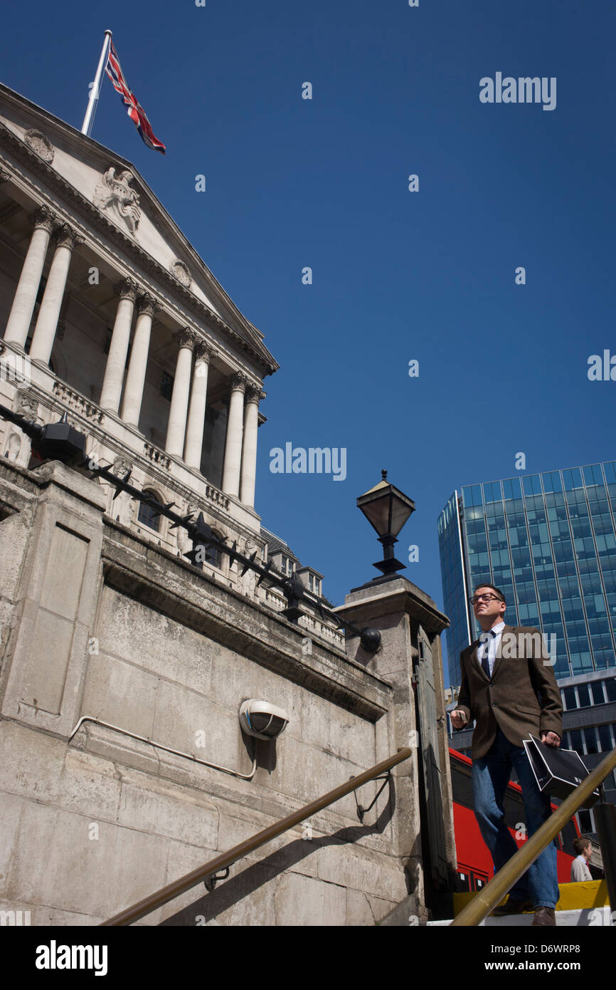 At Cornhill in the City of London, a businessman descends the steps into the London Underground, at Bank station, - Stock Image
