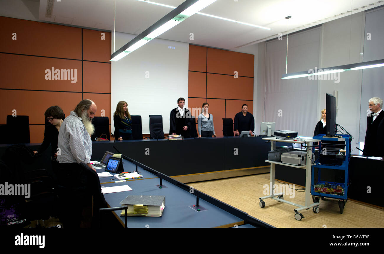 Presiding judge Ulrich Stein (M) opens the trial against the Jena youth pastor Lothar Koenig (2-L) at the the district Stock Photo