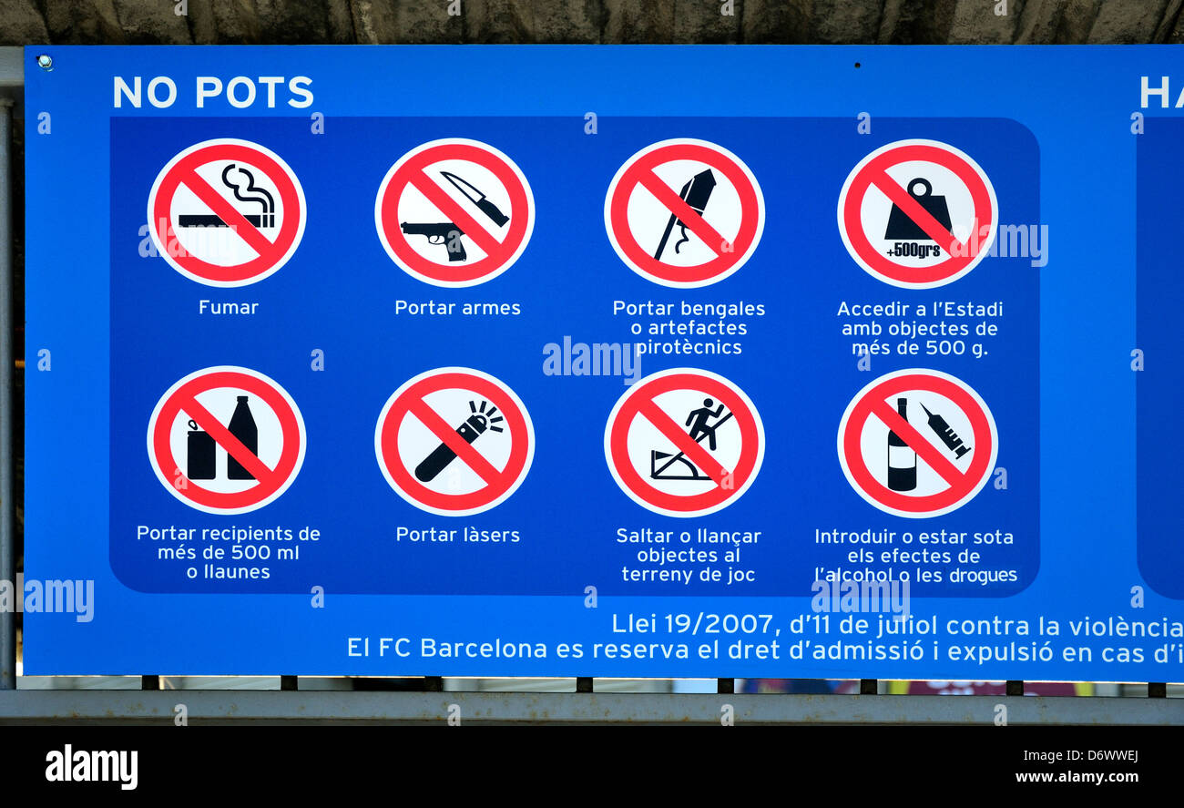 Barcelona, Catalonia, Spain. Sign at Camp Nou football staium listing regulations in the ground. Catalan Language - Stock Image