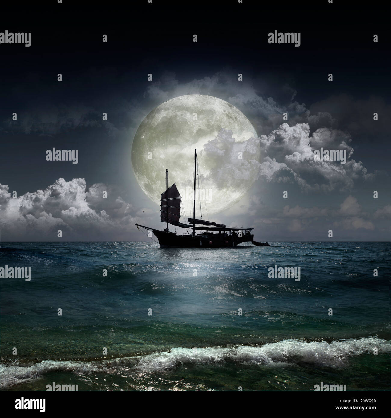 Magical evening on the ocean and the moon - Stock Image