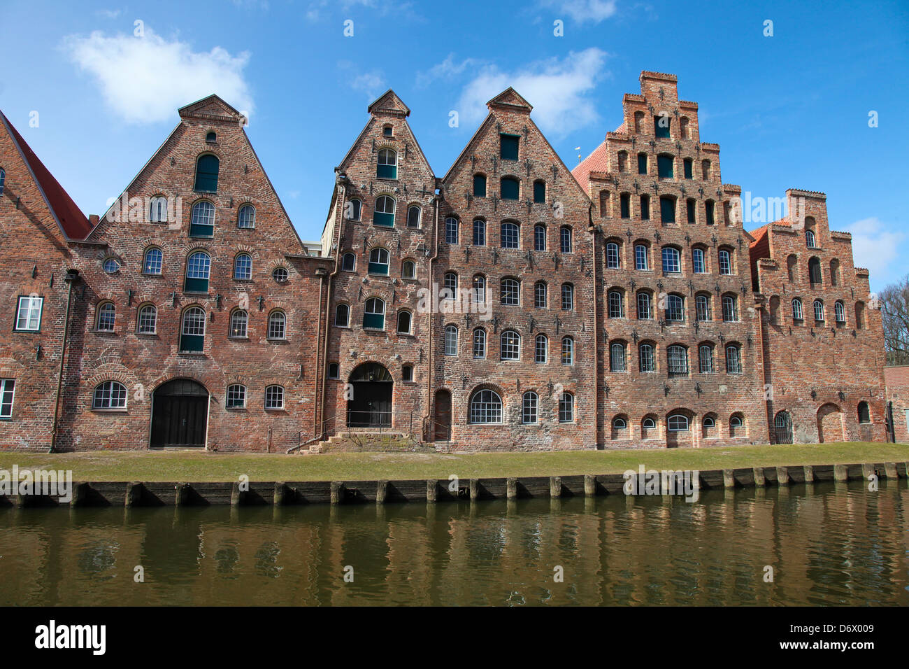 The Salzspeicher (salt storehouses) of Lübeck, Germany, are historic brick buildings on the Upper Trave River - Stock Image