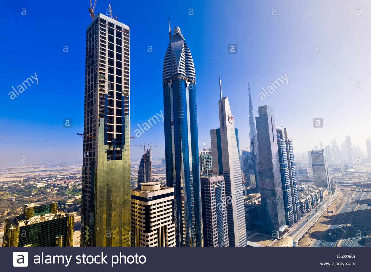 Overview of buildings on Sheik Zayed Road from the Sheraton Four Points Hotel (the Burj Khalifa, the tallest building - Stock Image