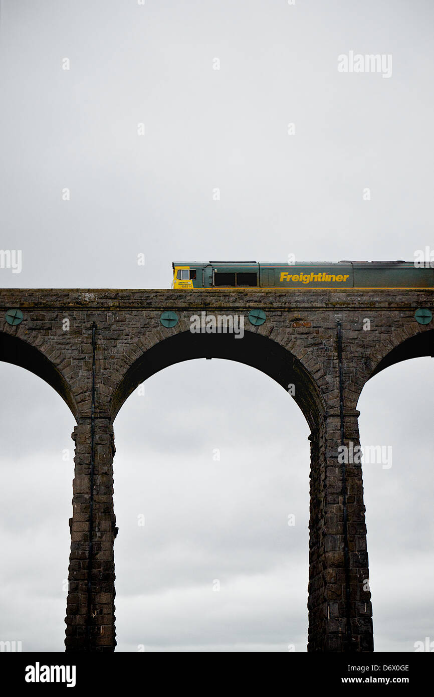 Ribblehead Viaduct in Yorkshire with a train crossing - Stock Image