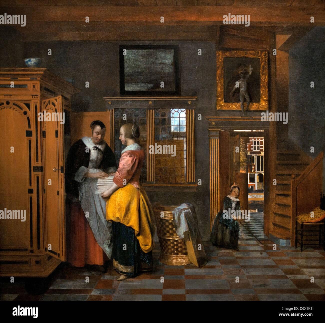 Interior with women in a linen closet 1663  Pieter de Hooch 1629 - 1684 Dutch Netherlands - Stock Image
