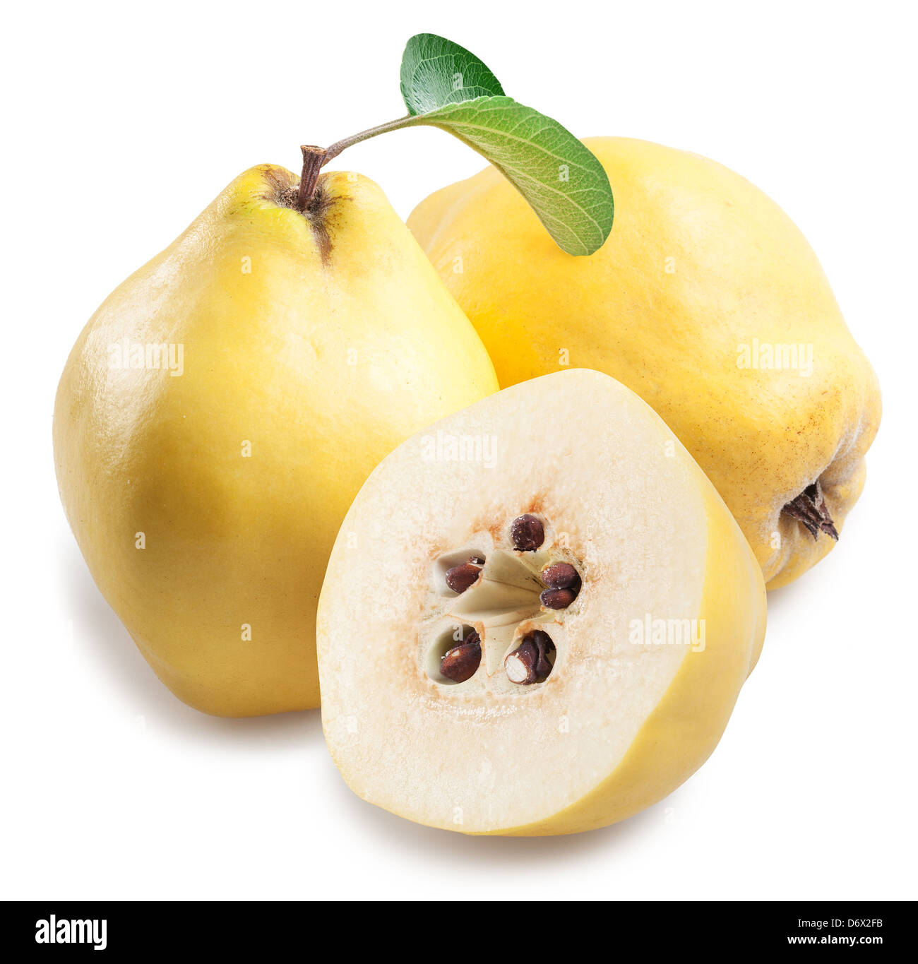Quince with slices on a white background. - Stock Image