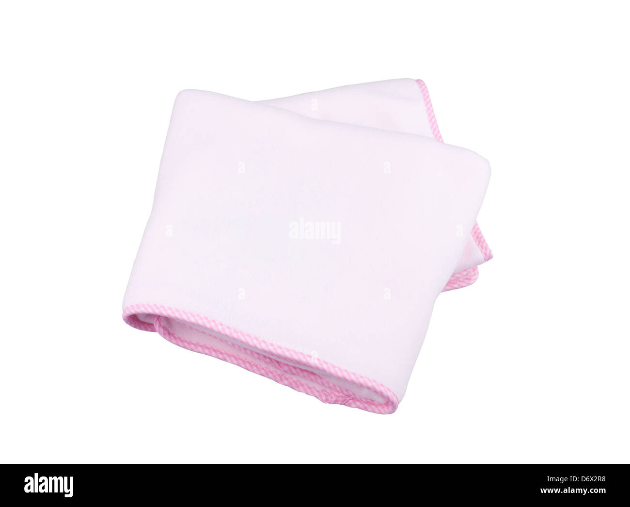 Pink fleece blanket for baby on white background - Stock Image