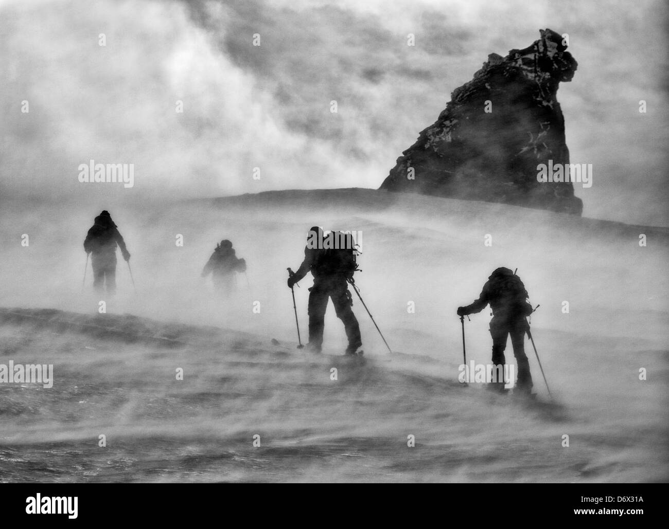 A windy morning ski touring on the Gran Paradiso Stock Photo