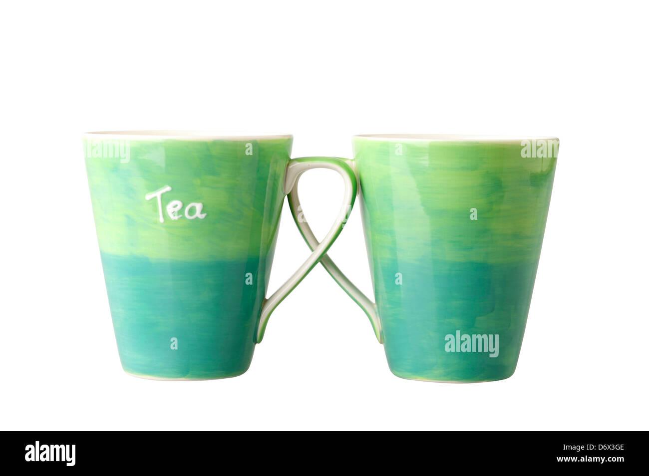Two green mugs nice for tea time - Stock Image