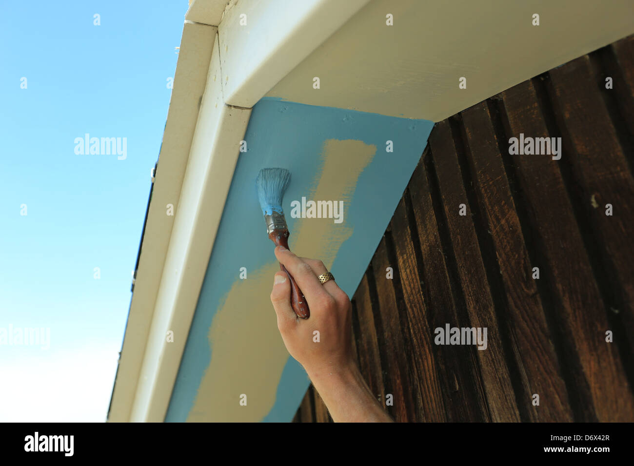 Remarkable Painter Painting Exterior House Roof Fascia Boards Stock Download Free Architecture Designs Xerocsunscenecom