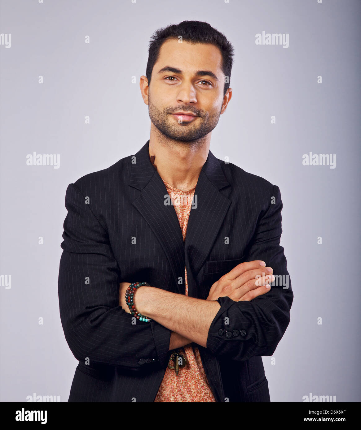 Studio shot of a confident casual middle eastern guy - Stock Image