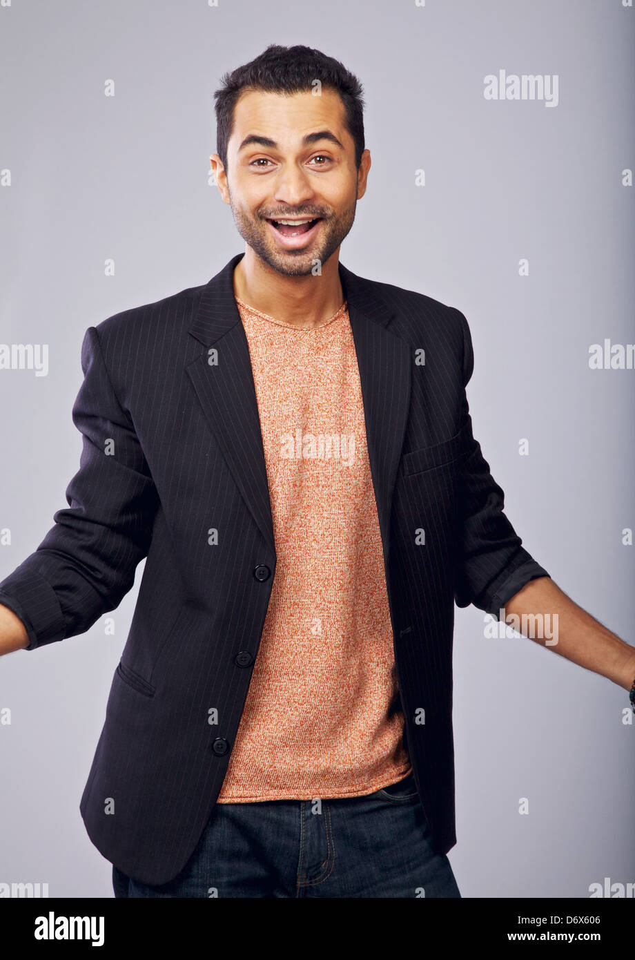 Portrait of a charming guy in a studio happy about something - Stock Image