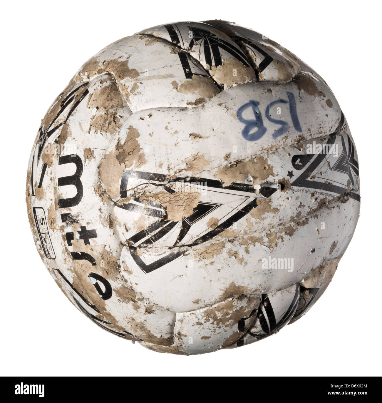 Old tired and worn out football - Stock Image