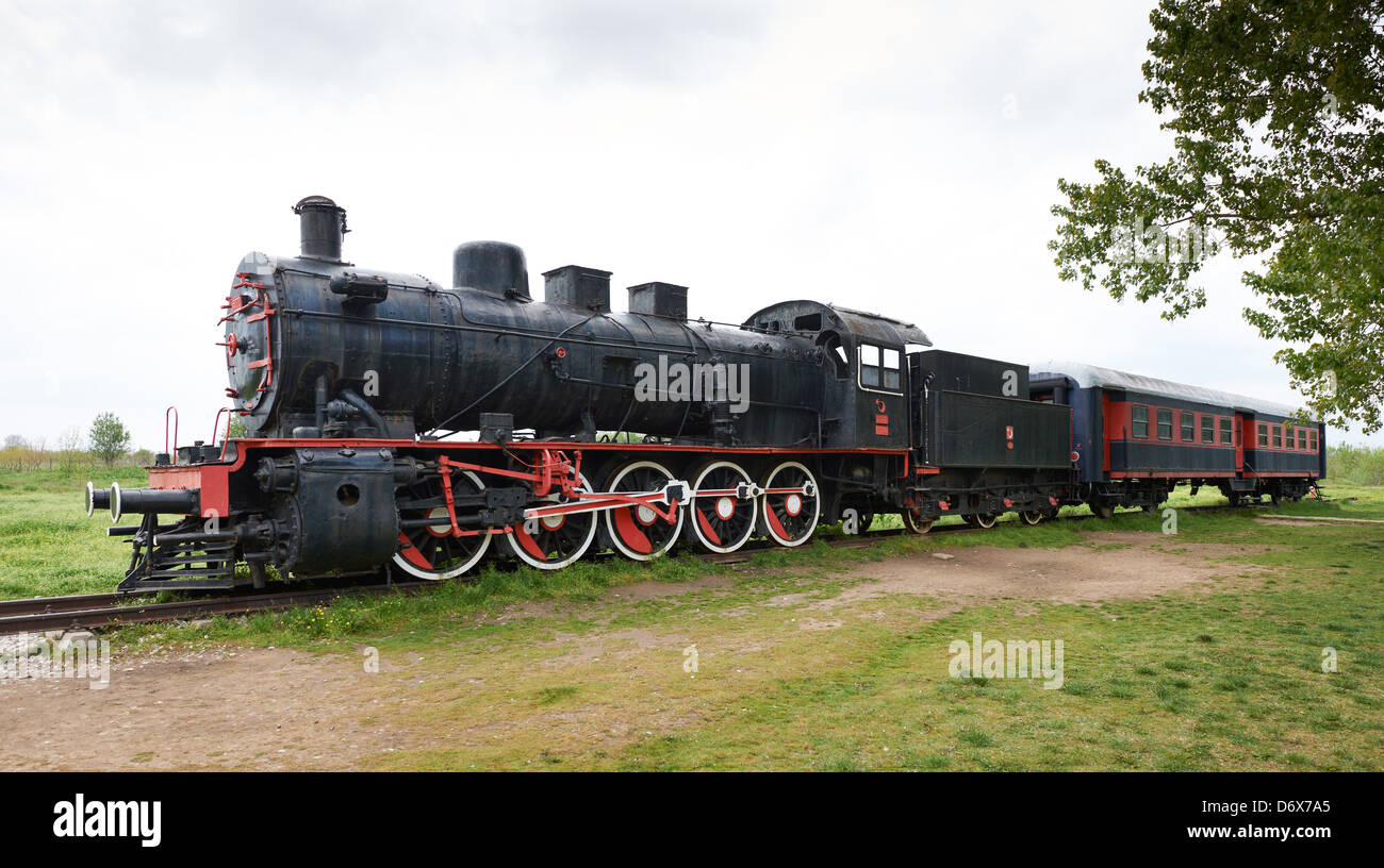 Original passengers steam-power train from the Orient Express era at the old railway station in Edirne, Turkey. - Stock Image