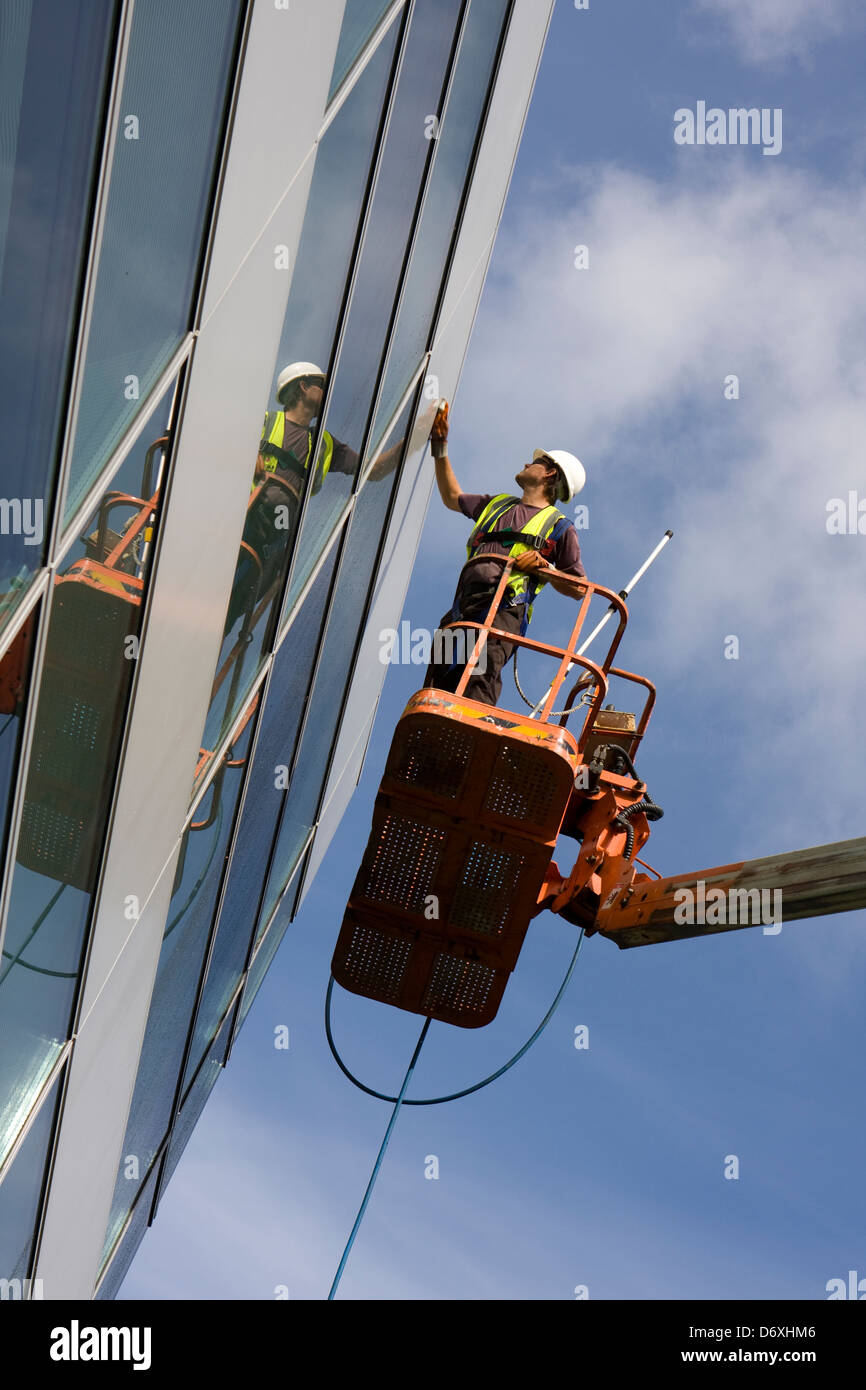 High level external building clean using access boom. - Stock Image