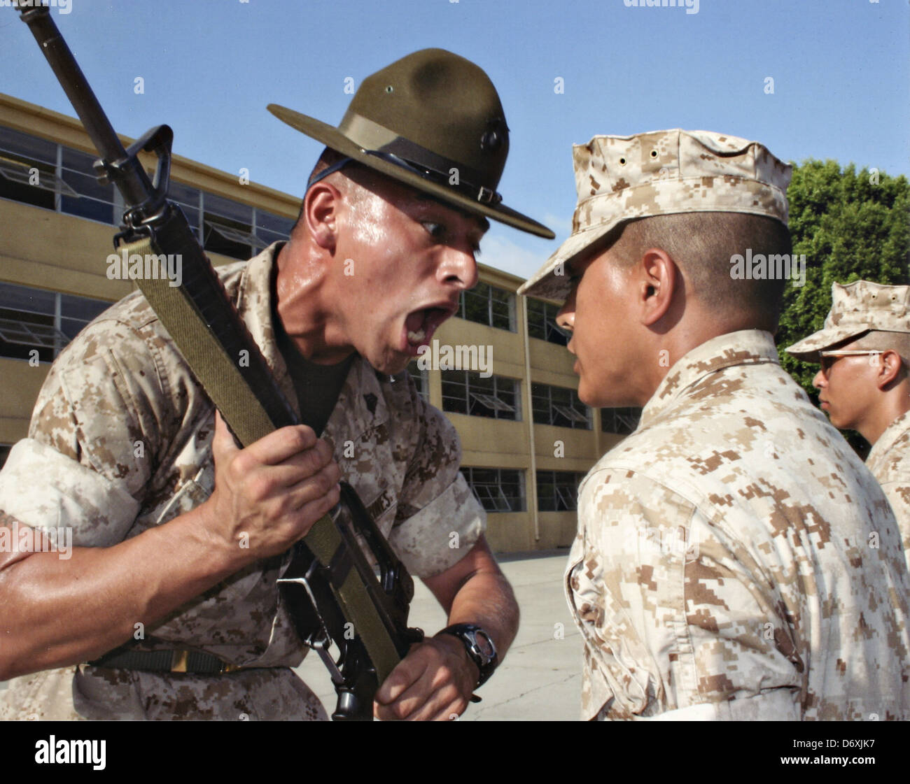 A Us Marine Corps Drill Instructor Screams At A Marine