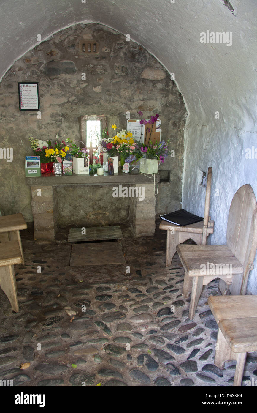 The Wales Coastal Path in North Wales. The chapel and altar at the Holy Well and Chapel of St Trillo at Rhos on - Stock Image