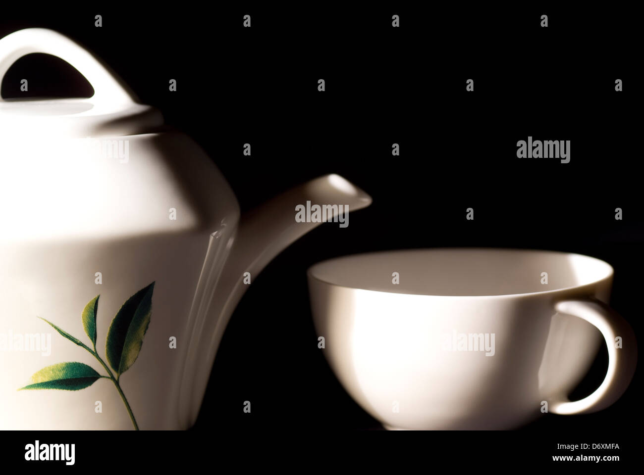 white porcelain kettle and cup to tea - Stock Image