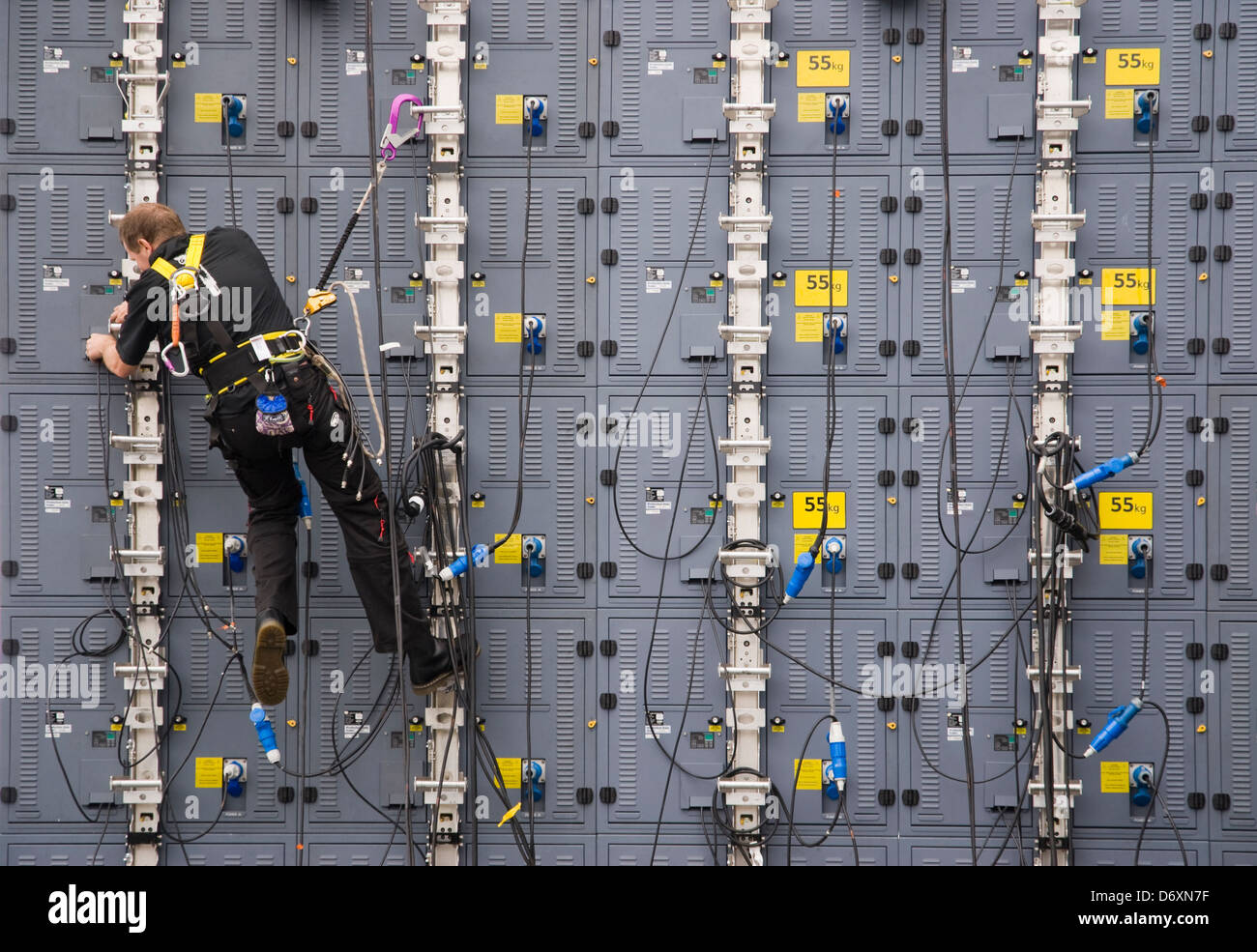 Video technician connecting video modules. - Stock Image