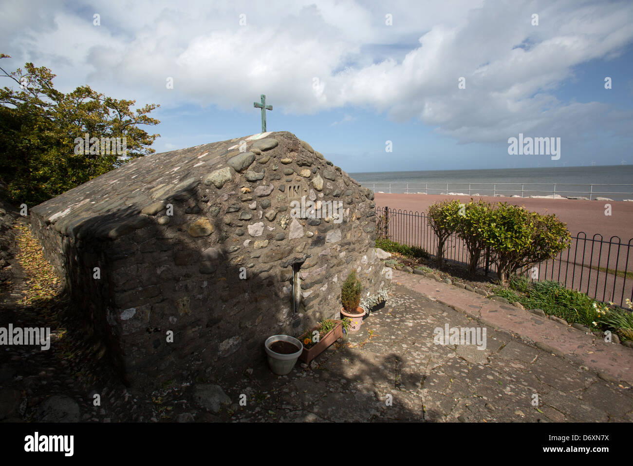 The Wales Coastal Path in North Wales. Picturesque view of the Holy Well and Chapel of St Trillo at Rhos on Sea. - Stock Image