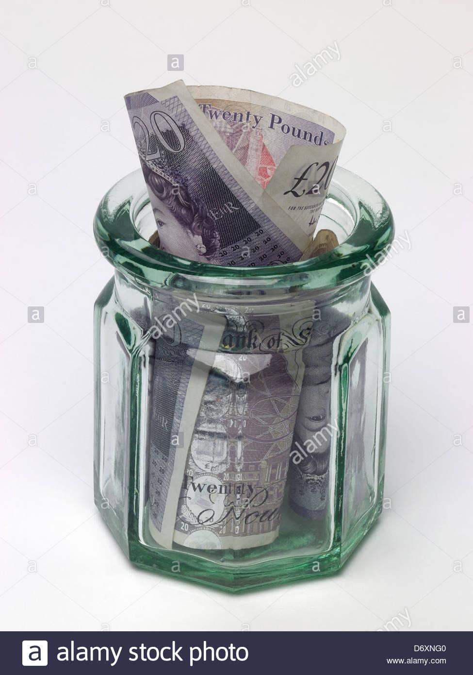 Jam jar with 20 pound notes - Stock Image